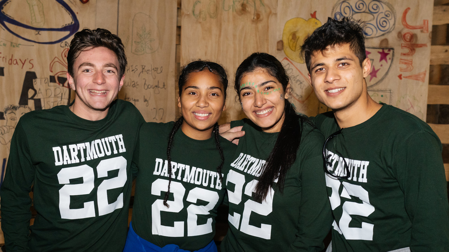 A photo of students at the bonfire wearing Dartmouth 22s tshirts