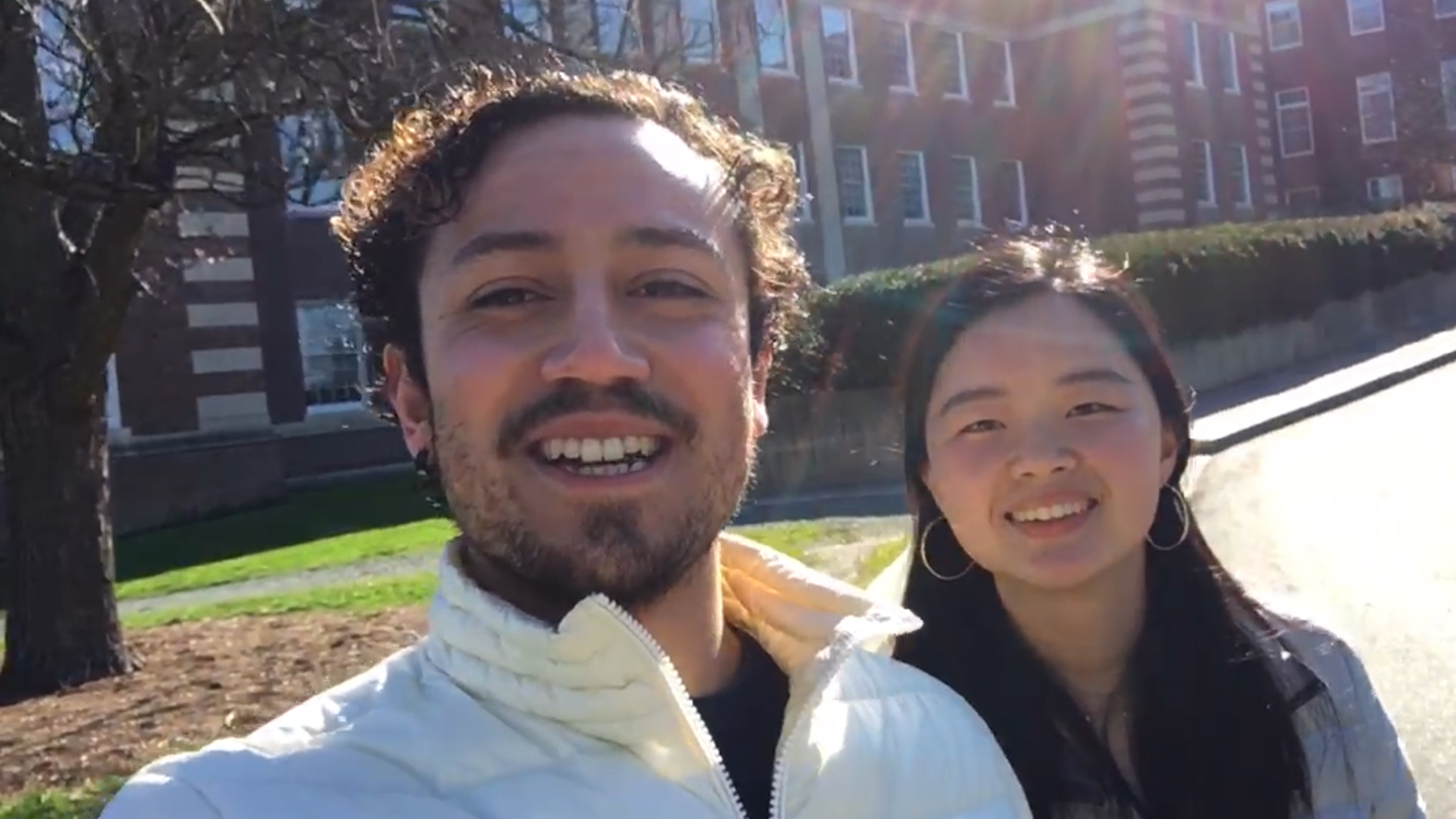 A photo of two students giving a campus tour