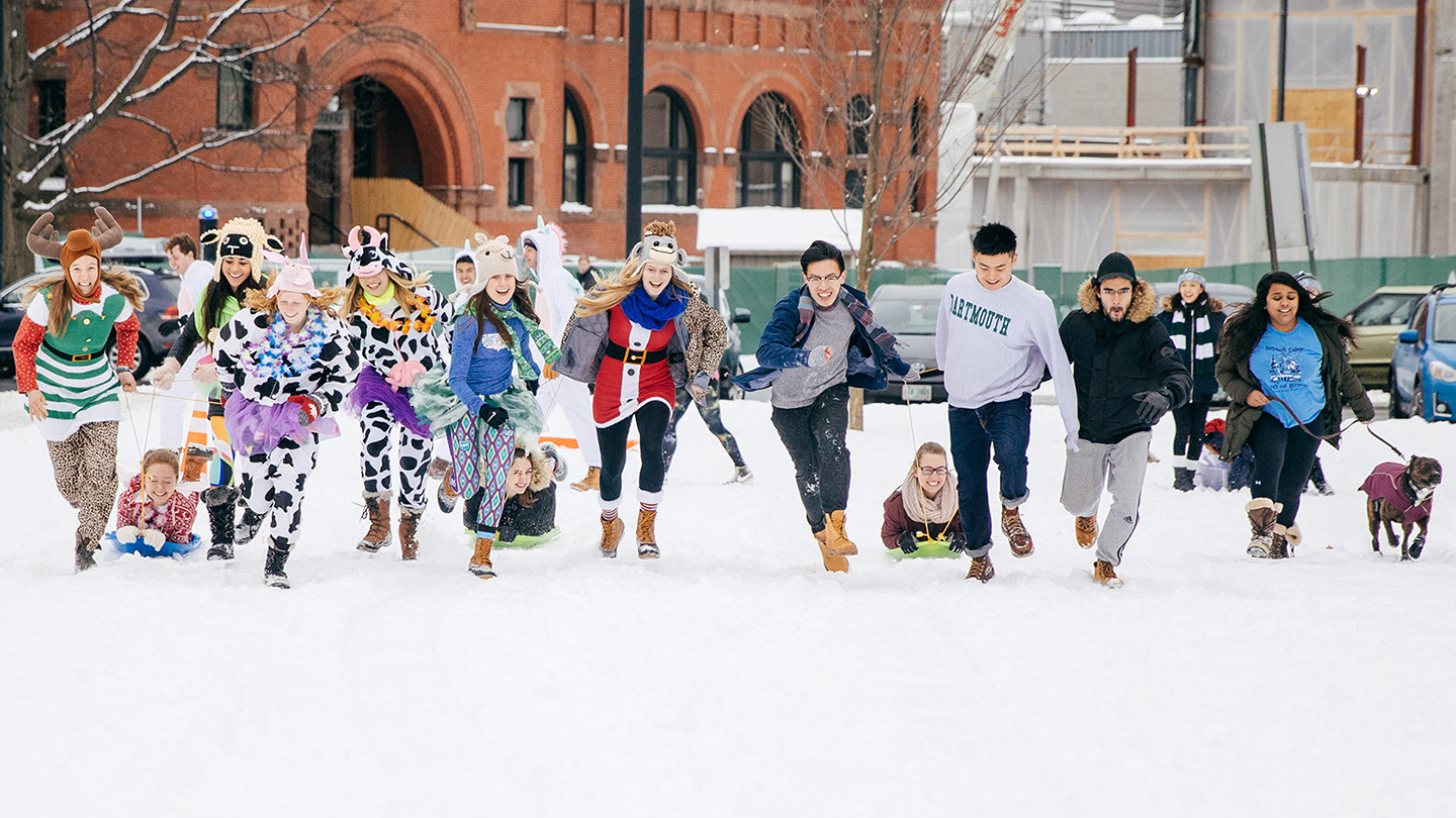 Photo of students participating in the human dog sled races