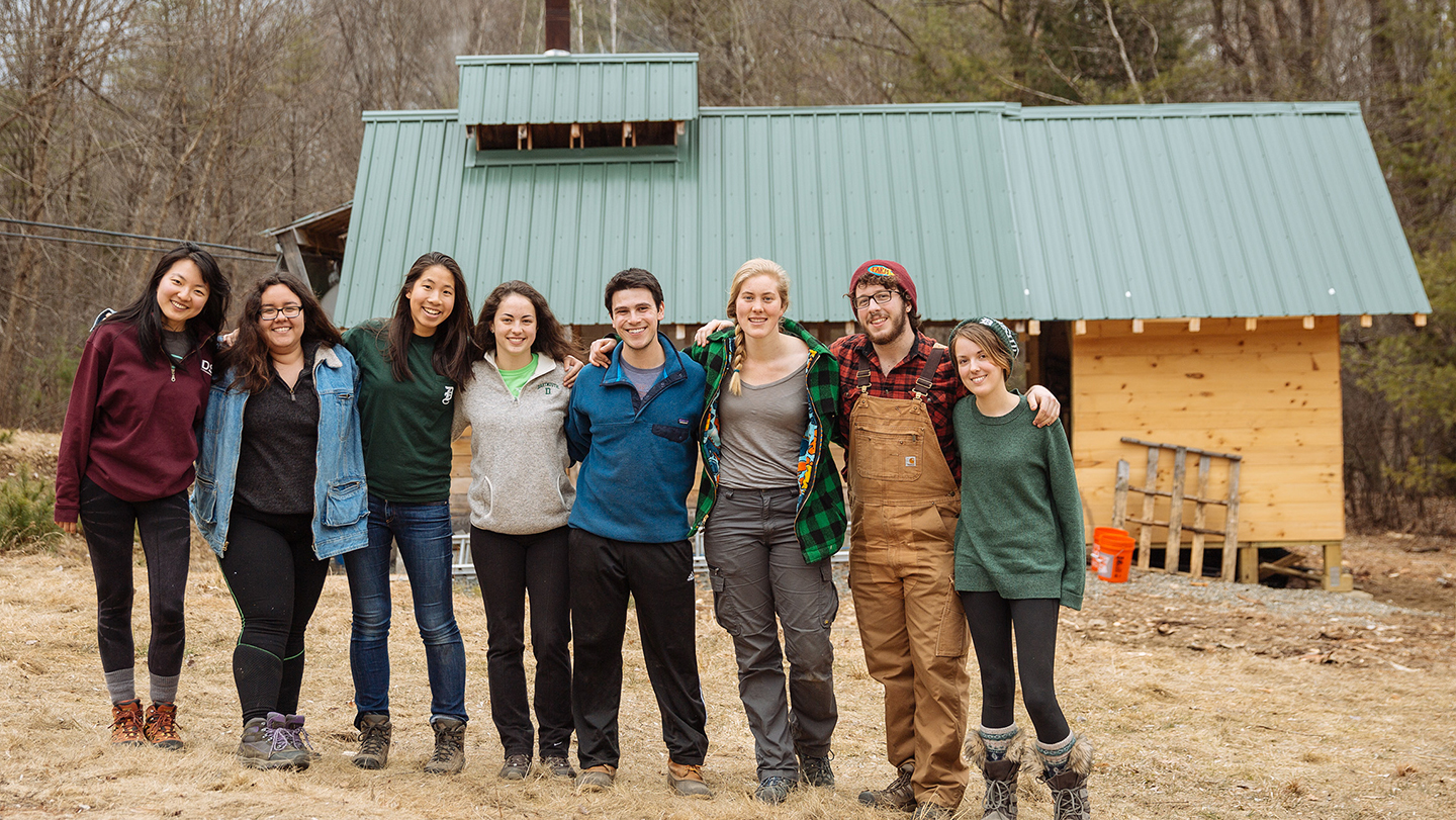 Photo of students in front of the Organic Farm's maple sugar house