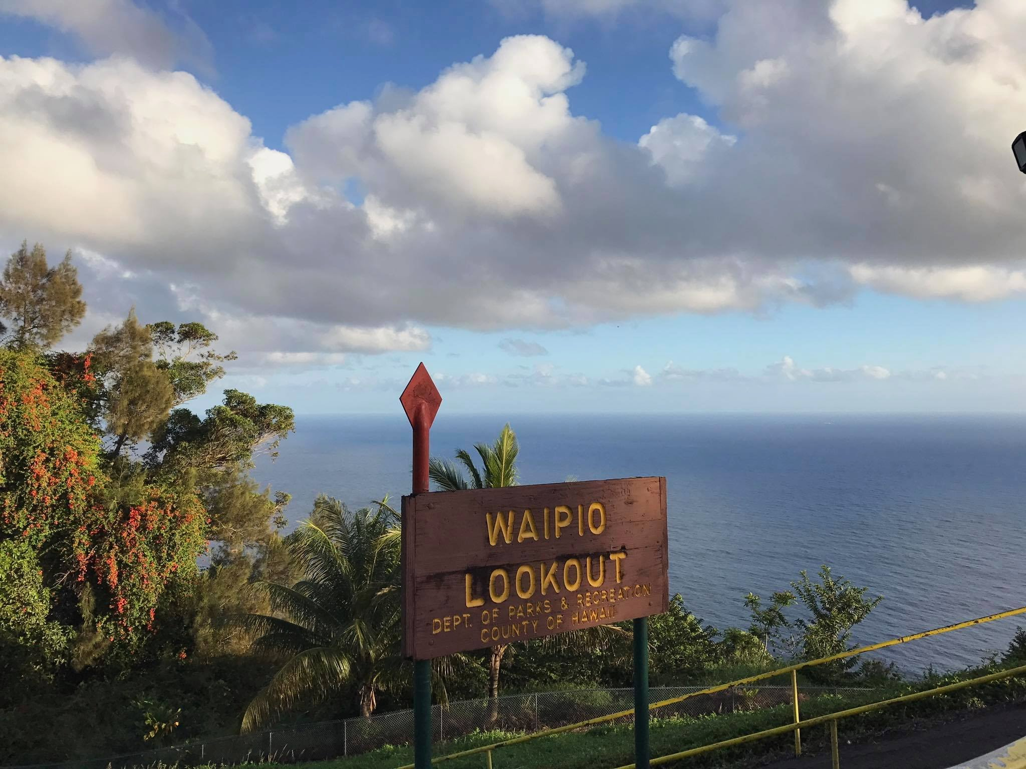 Sign and view of Waipio Valley