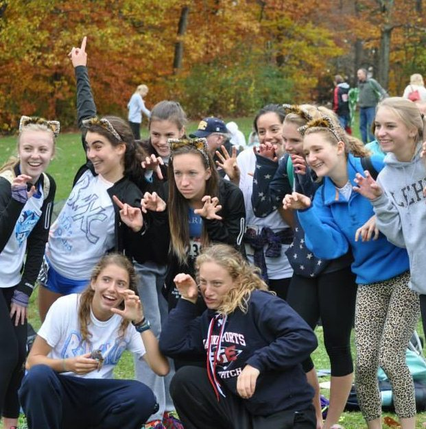 cross country team making funny pose for camera
