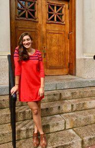 Adina in orange dress McNutt stairs