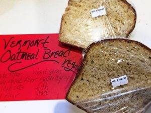 two pieces of bread with recipe card