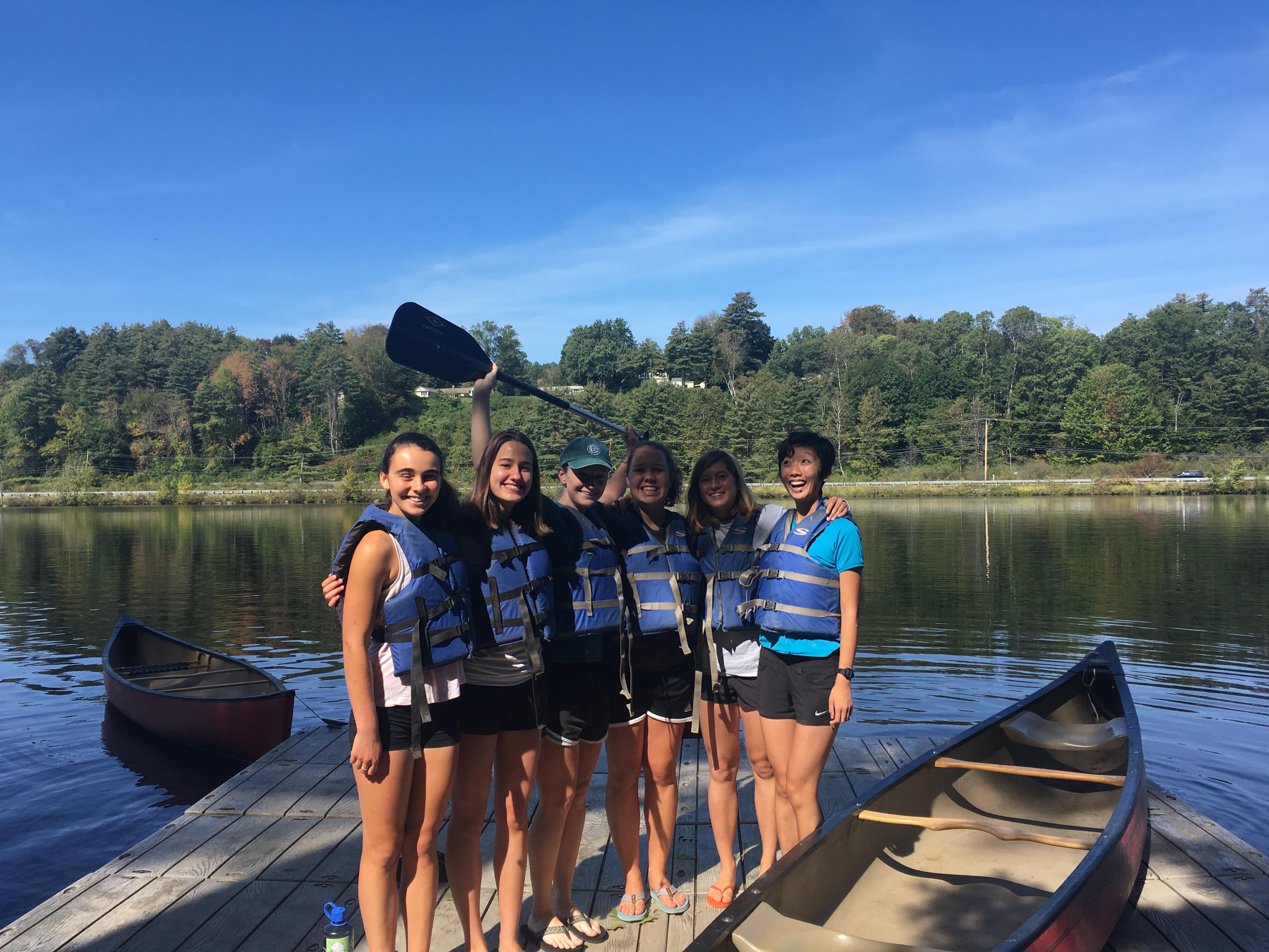 five girls on boat dock