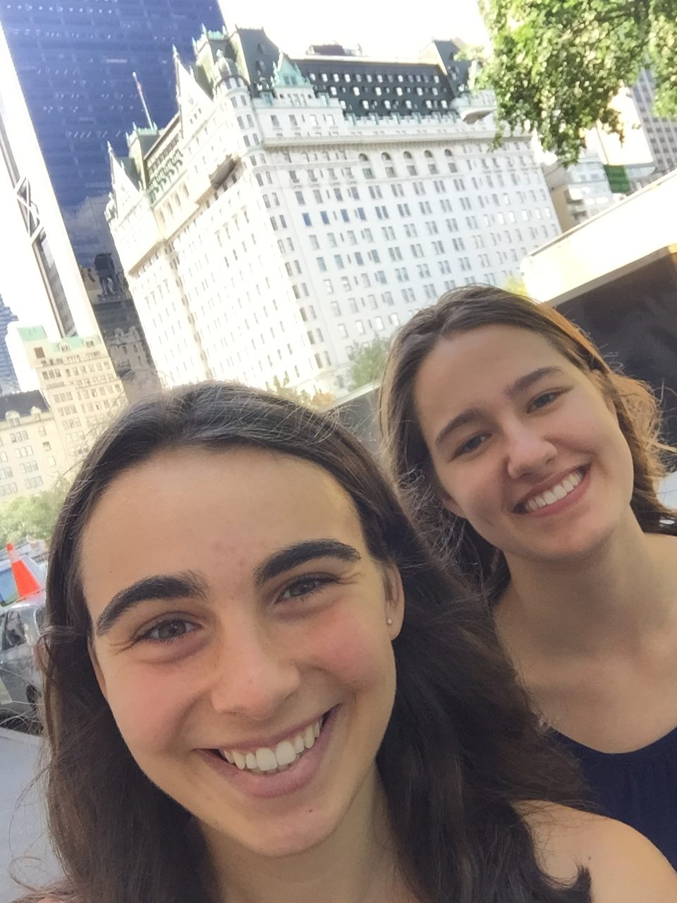 two girls before Plaza Hotel