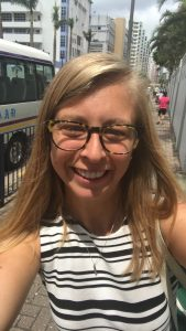 selfie of a young woman with blonde hair and glasses in downtown Hong Kong
