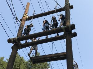 students doing a high ropes course