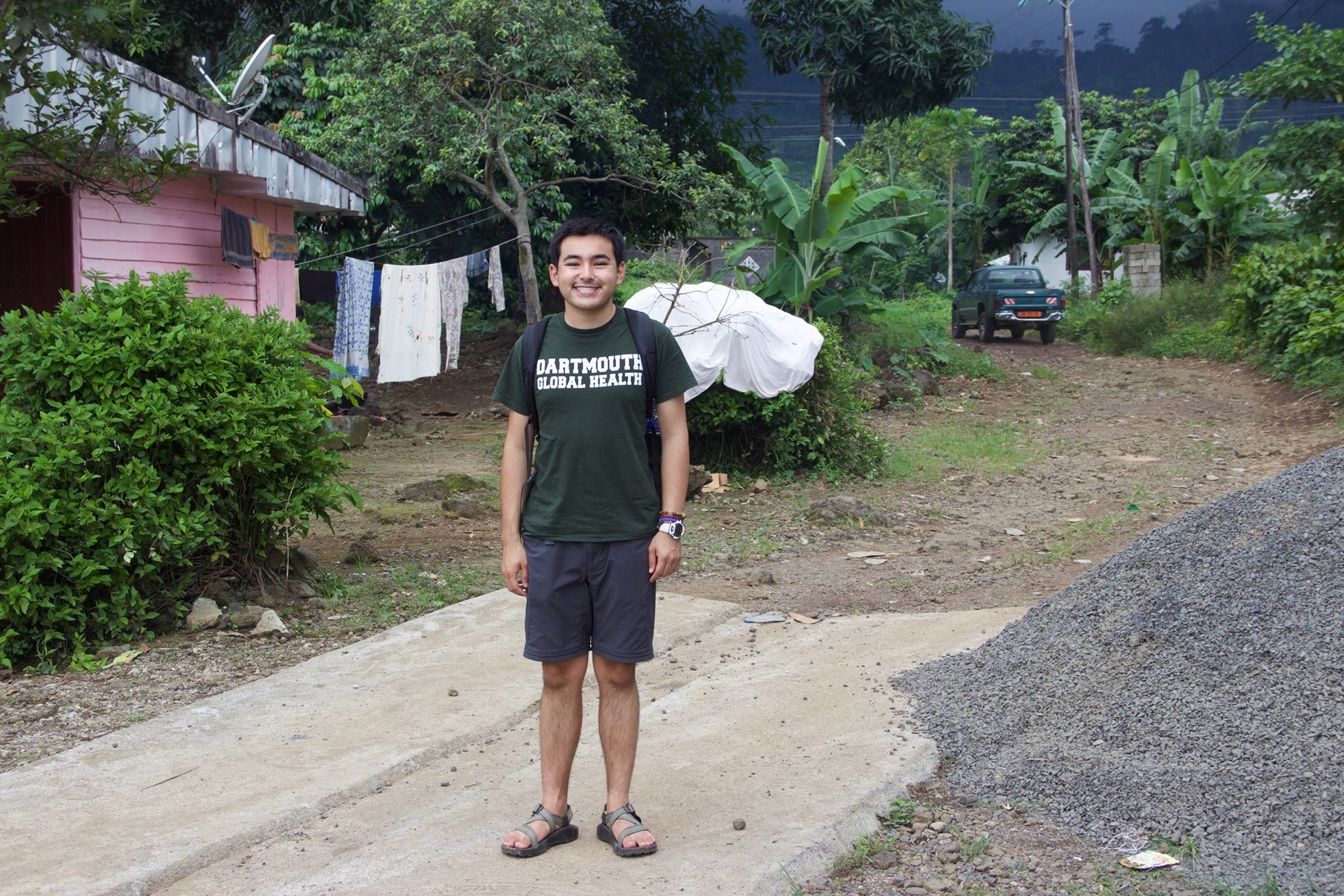 Dartmouth student in street of Cameroon village