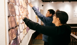 A photo of students looking at an exibit they curated