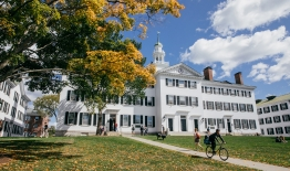 A photo of Dartmouth Hall with students going to classes