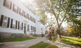A photo of students walking in front of Dartmouth Hall