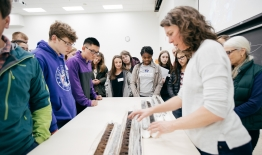 A photo of a professor showing students a core sample at Dimensions