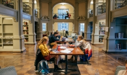A photo of students studying in the East Reading Room of Baker-Berry Library