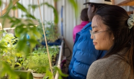 A photo of students touring a greenhouse on an Appalachia Energy Immersion Trip