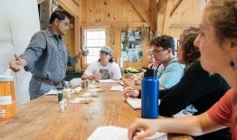 A photo of an environmental studies class at the organic farm