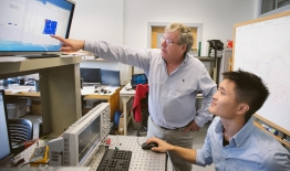 A photo of professor Eric Fossum and a student
