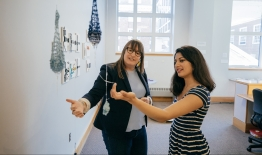 A photo of a student and professor looking at an art exhibit