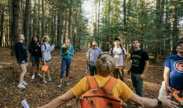 Photo of a geography class in the woods