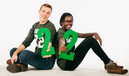 A photo of two students holding the number 22