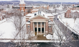 A photo of Rauner Library and campus with snow