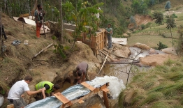 A photo of students working on hydropower in Rwanda