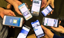 A photo of smartphones with social media on the screens