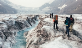 A photo of students in the Stretch program hike up the Athabasca Glacier in the Canadian Rockies to collect GPS data useful for measuring glacier velocity.