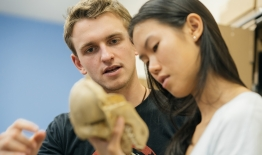 A photo of students in an anthropology class examining remains