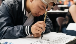 A photo of a student practicing Chinese caligraphy