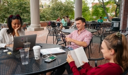 A photo of students studying on the porch at Collis