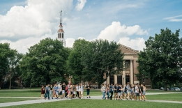 A photo admissions tours on The Green in summertime
