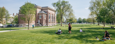 A photo of students on the Baker Library lawn
