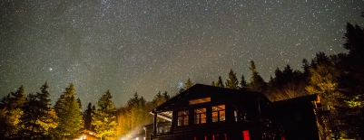 Image of Moosilauke Ravine Lodge at night under a stary sky
