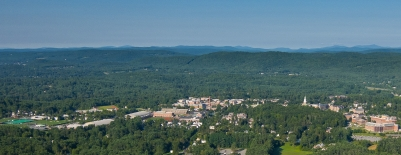 A photo of campus with Green Mountains and Killington in the background