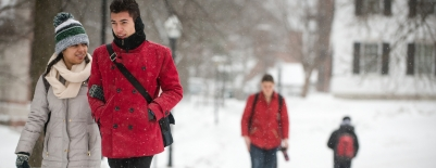 Photo of students walking through campus in snow