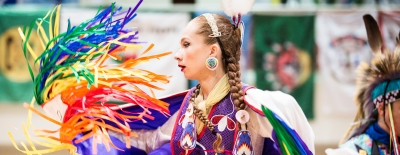 Photo of a student during the annual Powwow event