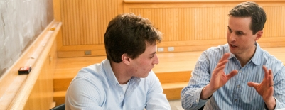 A photo of professor Brendan Nyhan and a student