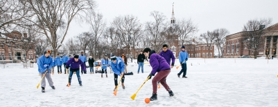 Photo of School House Community members playing Broomball as part of Winter Carnival activities