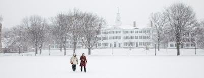 Photo of students walking across the green through the snow