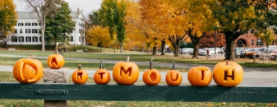 Photo of pumpkins carved with letters in them to spell out Dartmouth