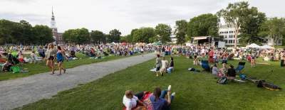 Photo of people enjoying a free concert on the Dartmouth Green
