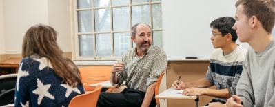 A photo of professor Michael Herron in the classroom with students