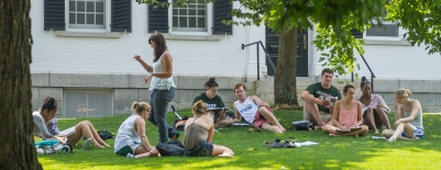 Photo of students having class in front of Dartmouth Hall