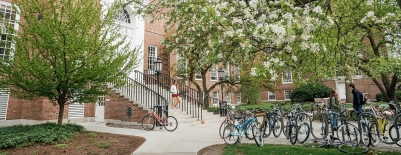 A photo of bikes outside of Baker Library in Spring