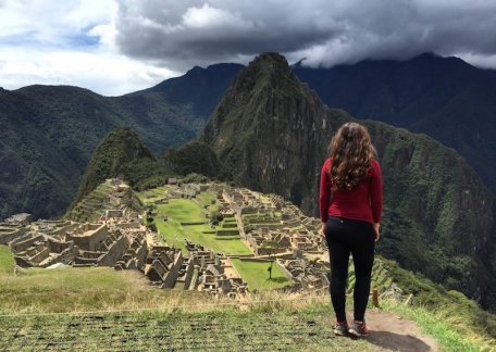 A students stands about Machu Picchu in Peru