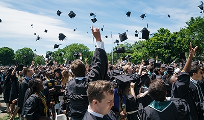 A photo of the Class of 2017 tossing their caps at graduation