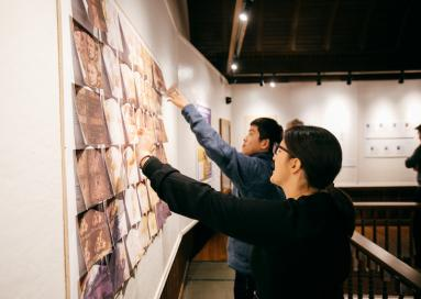 A photo of students at an exhibit.