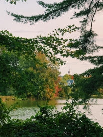 A picture of Baker Berry's bell tower from Occom Pond
