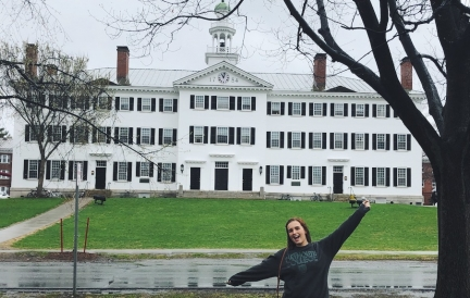 Abbi in front of Dartmouth Hall on a rainy day